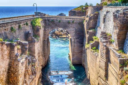 Rocks and architecture of the coast of Salento of the Ionian Sea in Italy,  in Santa Cesarea Terme, Lecce, Apulia Banco de Imagens