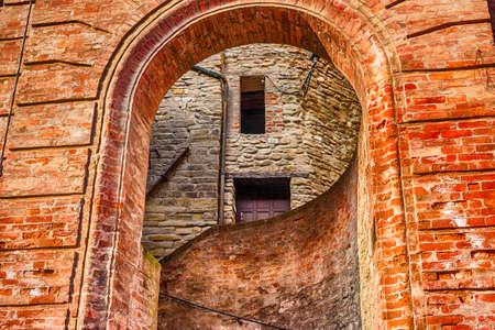 emilia: Round entry to alley  of Brisighella, hill village in Emilia Romagna in Italy