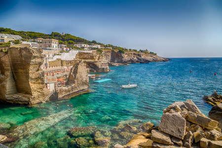 Rocks and architecture of the coast of Salento of the Ionian Sea in Italy,  in Santa Cesarea Terme, Lecce, Apulia Foto de archivo