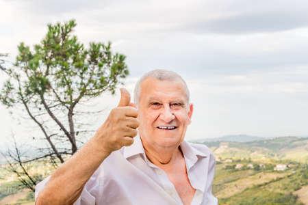 octogenarian: elderly octogenarian male makes thumbs up sign Stock Photo
