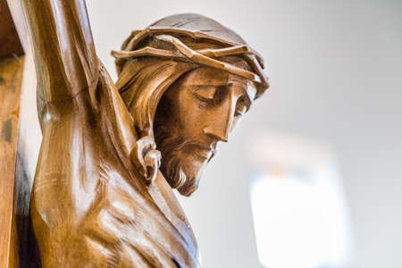 redemption: Celebrating the Good Friday, the face of Jesus Christ with crown of thorns dead on the cross Stock Photo