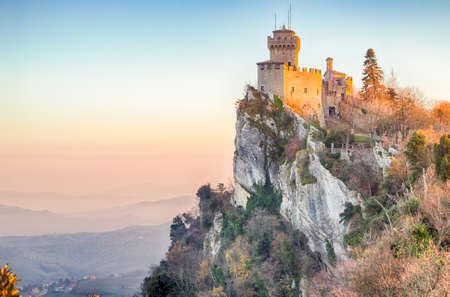 rises: fifteenth-century tower rises above the valley on Titano Mount in the Republic of San Marino