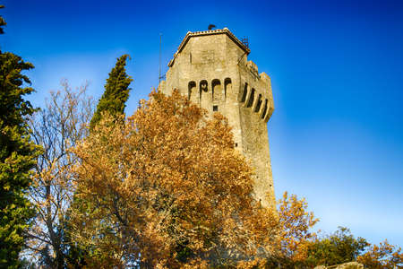 3rd ancient: Medieval tower behind branches in the Repubblic of San Marino Editorial