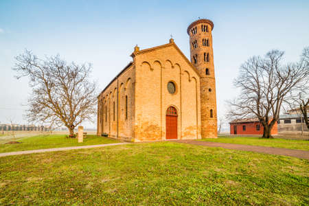 oldest: Ancient brick walls of an old Catholic church with one of the oldest  belltowers in Italy Stock Photo