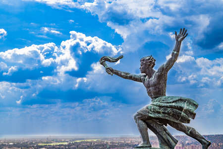 bearer: Cityscape and statue of torch bearer on Gellert Hill in Budapest, Hungary Stock Photo