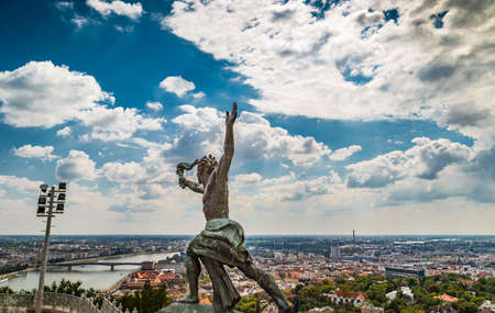 bearer: Cityscape and statue of torch bearer on Gellert Hill in Budapest, Hungary Stock Photo