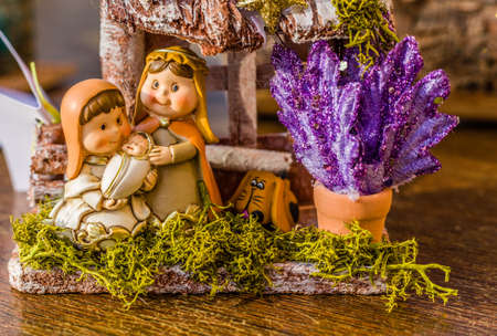 jesus statue: vivid colors of a Christmas Nativity scene, the Blessed Virgin Mary and Saint Joseph watch over the Holy Child Jesus in a manger