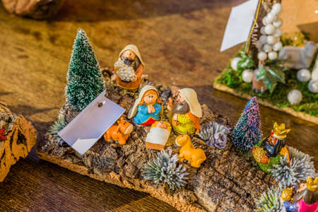 manger: vivid colors of a Christmas Nativity scene, the Blessed Virgin Mary and Saint Joseph watch over the Holy Child Jesus in a manger as the ox and the donkey are warming Stock Photo