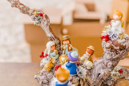 crib jesus: vivid colors of a Christmas Nativity scene, the Blessed Virgin Mary and Saint Joseph watch over the Holy Child Jesus in a manger as the ox and the donkey are warming Stock Photo
