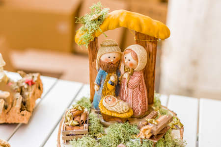 vivid colors of a Christmas Nativity scene, the Blessed Virgin Mary and Saint Joseph watch over the Holy Child Jesus in a manger