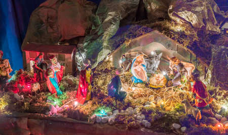 three wise men: Statues in a Christmas Nativity scene, the Blessed Virgin Mary and Saint Joseph watch over the Holy Child Jesus in a manger in the straw as the ox and the donkey are warming while the three wise men bring gifts of gold, frankincense and myrrh