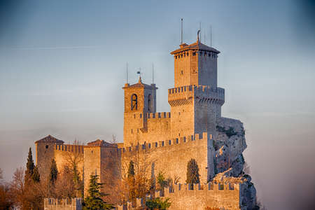 crenellated tower: bastions of crenellated tower overlooking the valley in San Marino Repubblic Editorial