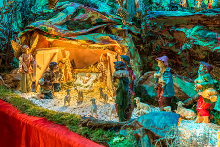 bring: Christmas Nativity scene, the Blessed Virgin Mary and Saint Joseph watch over the Holy Child Jesus as the ox and the donkey are warming while the three wise men bring gifts of gold, frankincense and myrrh