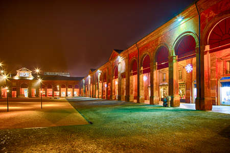 enclosed: Lights and Christmas decorations in an enclosed square surrounded by loggias and colonnades in Lugo, Italy