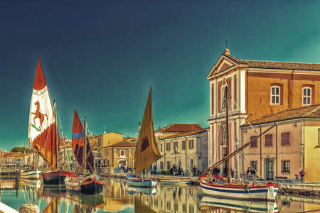 gat: Church and ancient saiboats on Leonardesque gat in Cesenatico in Italy