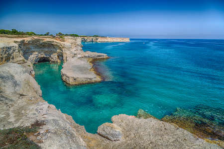 andrew: Rocky stacks of Saint Andrew Tower on the coast of Salento in Apulia in Southern Italy Stock Photo