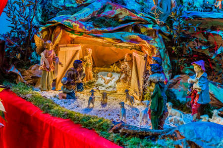 jesus mary joseph: Christmas Nativity scene, the Blessed Virgin Mary and Saint Joseph watch over the Holy Child Jesus as the ox and the donkey are warming while the three wise men bring gifts of gold, frankincense and myrrh