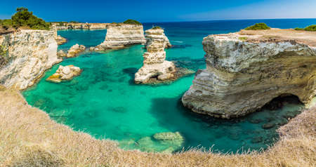 santo: Rocky stacks of Santo Andrea on the coast of Salento in Puglia in Italy Stock Photo