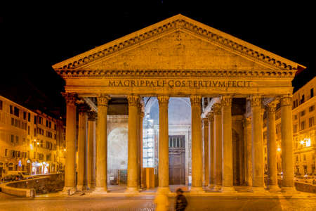 majesty: Night view of the majesty of the Pantheon in Rome with its imposing columns and ancient walls