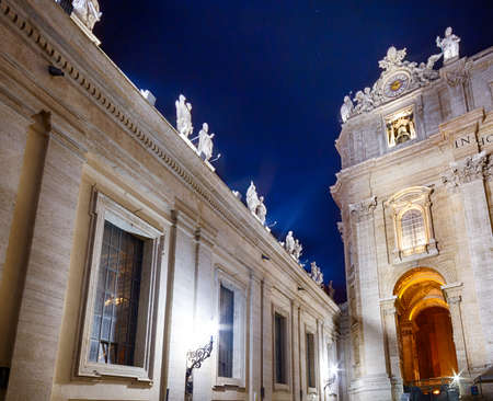 papal audience: Night view of facade of church in Vatican City with Holy doors, columns and statue