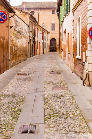 cobbled: Cobbled streets of country medieval city in Emilia Romagna, Italy Stock Photo
