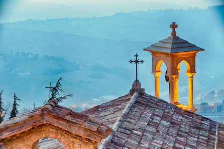 hilly: Village in hilly countryside around the Republic of San Marino in winter, roof of church