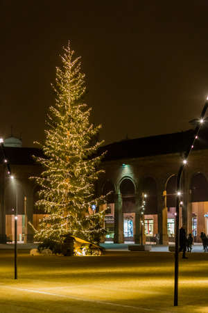 enclosed: Lights and Christmas decorations and Christmas tree in an enclosed square surrounded by loggias and colonnades in Lugo, Italy Stock Photo