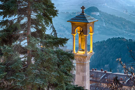 Village in hilly countryside around the Republic of San Marino in winter, roof of church