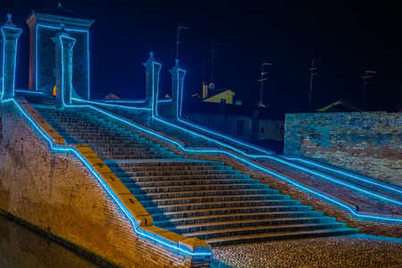 comacchio: ancient bridge at night lit by Christmas lights in Comacchio, the Little Venice, in Italy Stock Photo
