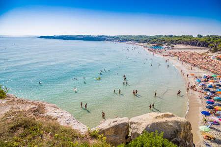 beach facilities on bay near rocky cove on the coast of Salento in Puglia in Italy Stock Photo
