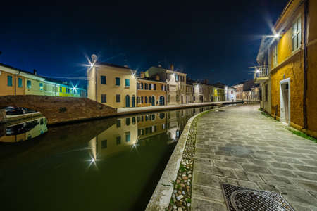 comacchio: night view of the streets and canals of Comacchio, the little Venice of Emilia Romagna, illuminated by lights and decorations during Christmas