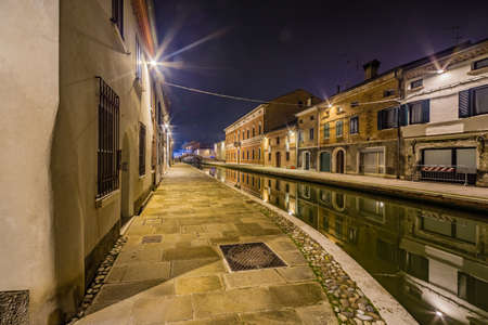 emilia romagna: night view of the streets and canals of Comacchio, the little Venice of Emilia Romagna, illuminated by lights and decorations during Christmas