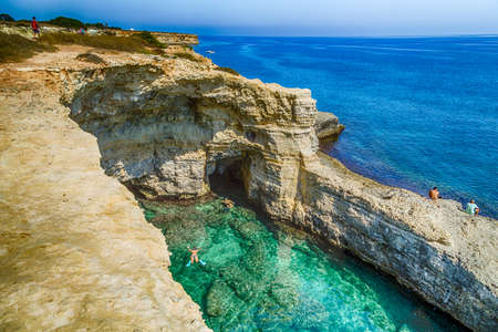 Rocky stacks of Saint Andrew Tower on the coast of Salento in Apulia in Southern Italy Banco de Imagens