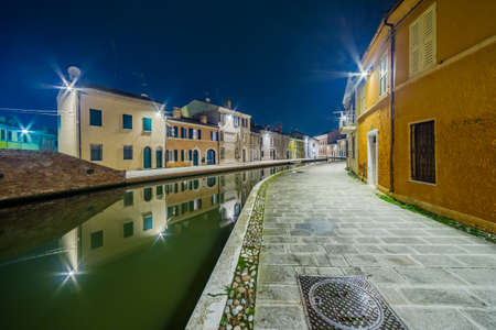 the little venice: night view of the streets and canals of Comacchio, the little Venice of Emilia Romagna, illuminated by lights and decorations during Christmas