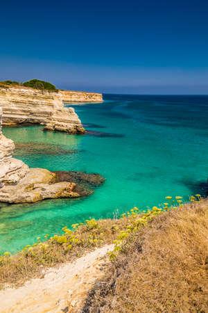sea cliff: Rocky stacks of Santo Andrea on the coast of Salento in Puglia in Italy Stock Photo