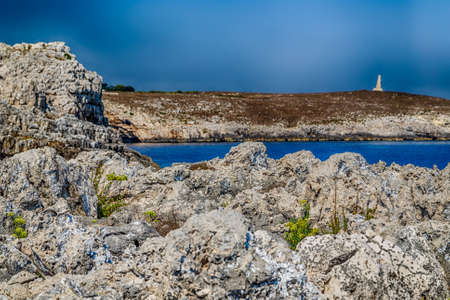 sea snake: the blue sea and the wild, rocky coast of Salento close to the Tower of the Serpent, ancient watchtower near Otranto in Puglia in Italy.