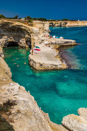 sea cliff: Rocky stacks of Saint Andrew Tower on the coast of Salento in Apulia in Southern Italy Stock Photo