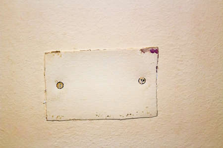 badly: cover badly done by hand for electrical box into the wall