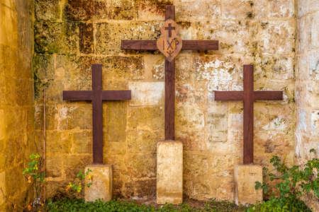 golgotha: three wooden crosses on Mount Golgotha