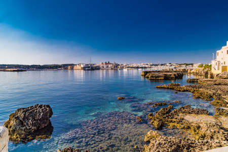 clear waters: Rocks and clear waters in sea ay of Apulian ancient town in Italy Stock Photo