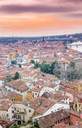 reddish: Reddish sky over Verona in Italy