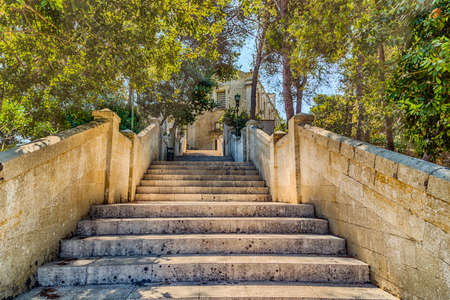 high steps of an ancient staircase that leads to a church Stock Photo - 52901396