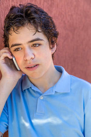 mouthed: pensive teenager while talking on cell phone Stock Photo