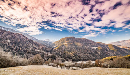 cloud capped: reddish sky on snow-capped mountains Stock Photo