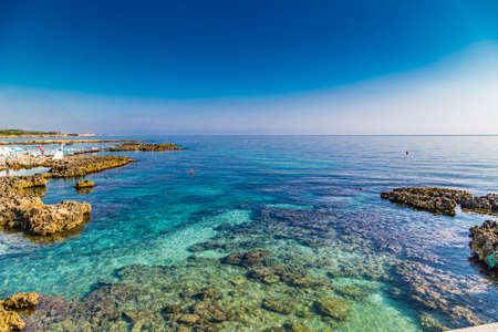 Rocks and clear waters in sea ay of Apulian ancient town in Italy Фото со стока