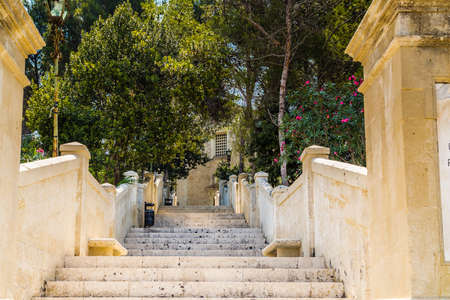 high steps of an ancient staircase that leads to a church Stock Photo