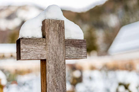 jesus standing: standing wooden cross  covered by snow Stock Photo
