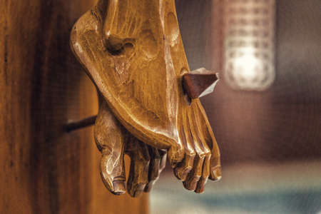 nailed: Celebrating the Good Friday, the feet of Jesus Christ nailed to the Holy Cross Stock Photo