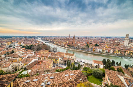 romeo juliet: panorama of the Adige River as it passes through the houses and historical buildings of Verona in Italy, known as romantic city of love because Romeo and Juliet by Shakespeare was set here