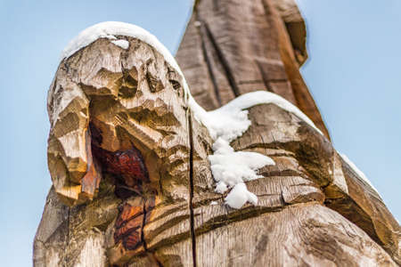 crucified: statue of Jesus Christ crucified covered by snow